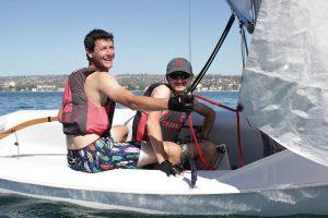 Sailing Club, two students sailing by Sailing Club