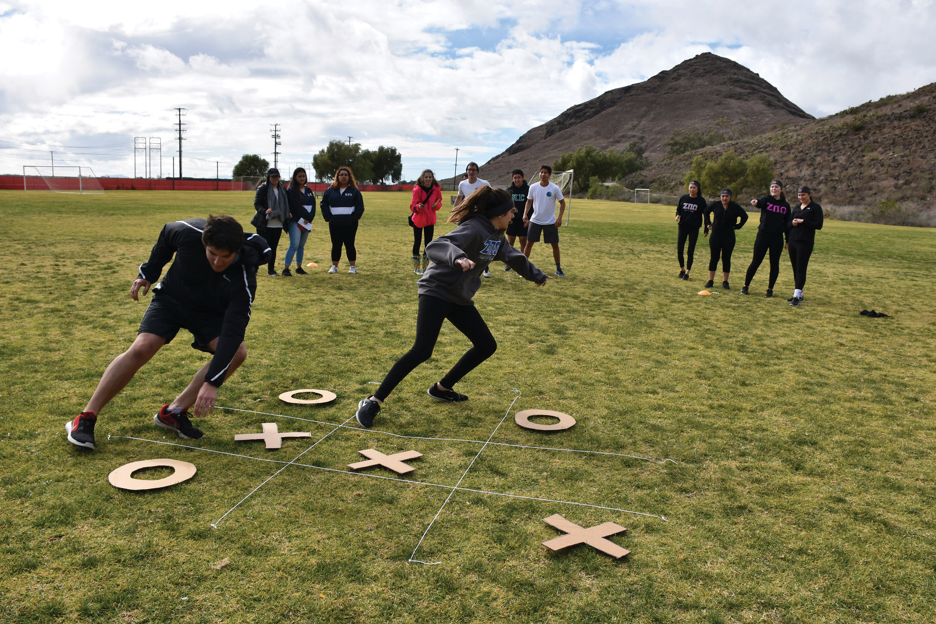 Students race to complete a tic-tac-toe game. Tic-tac-toe was one of many games being played during Kappa Rho Delta's Relay for Relay event to raise money for charity. Photo credit to Sarina Galindo.