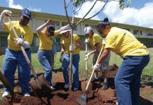Members of the U.S. Navy plant a tree on Earth Day. Earth Day is celebrated internationally on April 22 every year.