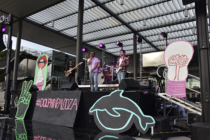 The band Road Brothers performs on the Dolphinpalooza stage. Photo credit to Sarina Galindo.