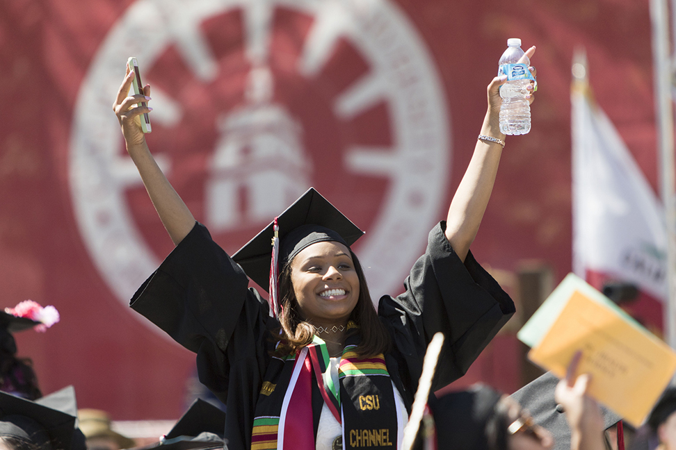 Courtney Chappell poses on the stage during the 2017 commencement ceremony. Photo credit to CSU Channel Islands Events.