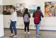 Students observe student art put on display in Napa Hall during the 2018 art show. Photo credit to CI Communication and Marketing.
