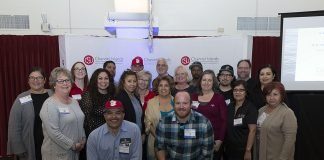 Faculty and staff pose for a group photo during the 2018 Staff Service Awards. Photo credit to CSU Channel Islands Events.