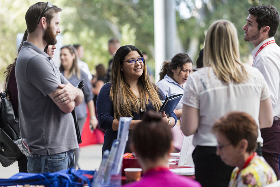 Students stop by a booth at CI's spring Career and Internship Fair. The Career and Internship Fair is held every semester as a way for students to connect with local employers. Photo credit to CI Communication and Marketing.