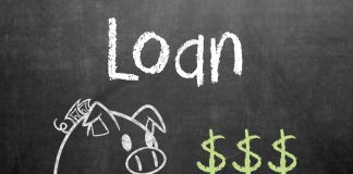 "A picture of the word ""Loan"" and a piggy bank on a chalkboard. Photo credit to GotCredit."