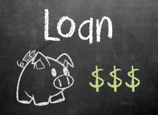 """A picture of the word """"Loan"""" and a piggy bank on a chalkboard. Photo credit to GotCredit."""
