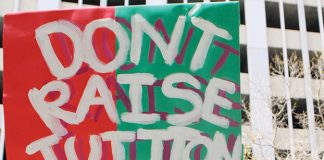 "A protestor holding a sign that says ""Don't Raise Tuition."" Photo credit to Neon Tommy."