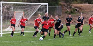CI Women's Soccer Club play a competitive game. Soccer is a team sport offered at CI as an intramural and club sport. Photo credit to CI Communication and Marketing.