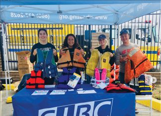 Students table for the Channel Islands Boating Center at an event. The Boating Center is free for all students. Photo credit to csuci_rec Instagram.