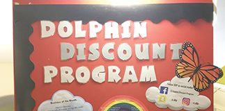 A photo of the Dolphin Discount Program (DDP) board in the Student Union. The DDP provides CI students with various discounts from local businesses. Photo credit to Ivey Mellem.