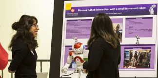 A student discusses her capstone project with an observer at the 2017 SAGE Conference. Photo credit to CI Communication and Marketing.