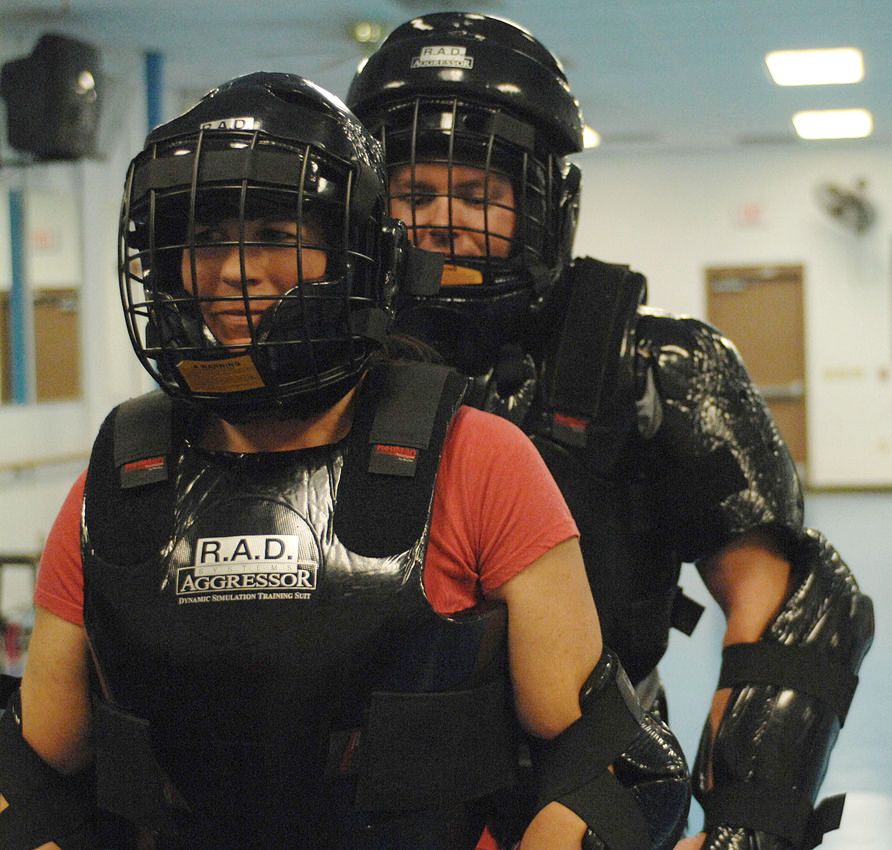 A Rape Aggression Defense (R.A.D.) instructor prepares to run an attack simulation with a student during a R.A.D. class. R.A.D. is designed to teach self-defense and preventative measures against sexual assaults and other attacks.