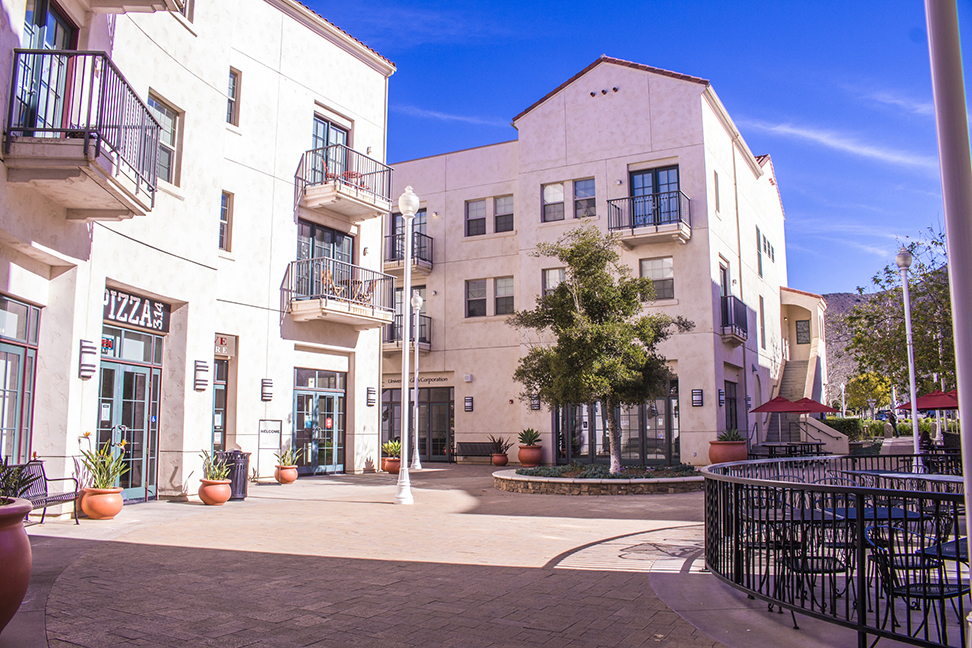 The entrance to Town Center from the main campus. To the left sits Pizza 3.14 and the Cove Bookstore. Photo credit to CSUCI Admissions.
